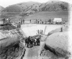 Crews completing the first culinary water reservoir on Reservoir Hill, Brigham City, Utah, July...