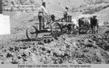 Road leveler at work on dike at Oneida Reservoir, Idaho, Sept. 16, 1917