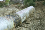 Large pipe going up a dirt hill
