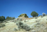 Yellow vehicle atop a hillside