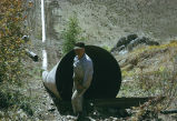 Man in front of pipe opening