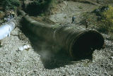 Men with eroded  and new pipe