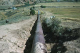 Pipe next to dirt road