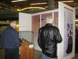 Two Visitors near the Australia display during the opening night reception of the Bells exhibit;