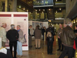 Visitors and library staff viewing various exhibit displays and socializing during the opening...