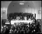 Interior of LDS 3rd Ward Church during a funeral;