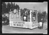 "Kiwanis Club float for Peach Days - Sign reads: ""Our Motto, We Build"""