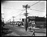 Main Street of Brigham City, decorated with American flags and bunting in preparation for a parade;
