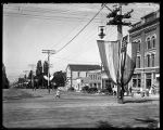 Street scene showing Forest Street looking West from Main, Brigham City, decorated with flags and...