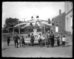 Ring-tossing booth at a fair;
