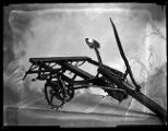 Small scale model of an early horse-drawn piece of farm equipment (1 of 2);