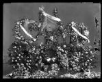 Funeral flower arrangement with small portrait of an unidentified man;