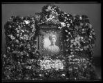 Funeral flower spray with portrait of unidentified woman (2 of 2);