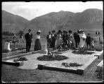 Mourners at an unidentified grave;