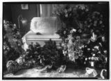 Casket and funeral flowers (commissioned by Mr. E.. J. Berger)