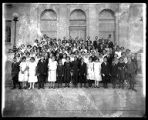 Group of young students and teachers in their best dress, in front of the Federal Building in...