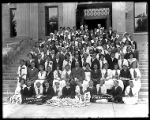 Graduation portrait of Whittier School children gathered on the front steps of the Box Elder...
