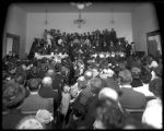 Interior view of an LDS ward meeting house during worship services;