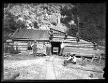 Log shaft house at entrance to Baker Mine in Baker Canyon;