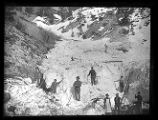 Men at Baker Mine, Baker Canyon, apparently digging out of an avalanche;