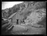 Log cabin, probably near Baker Mine in Baker Canyon;