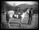 Fred W. Peterson of Thatcher, Utah, with a saddle horse (1 of 2);