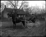 F. T. Truxell posed in new buggy on the streets of Brigham City;