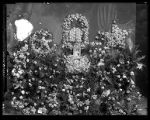 Floral display and portrait for the funeral of Mrs. M. N. Gilbert (1 of 2);