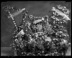 Floral display and portrait for the funeral of Florence Wilde Johnson;