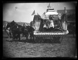 Horse-drawn float at an Independence Day parade;