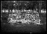 Kindergarten class, some wearing paper hats;