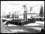 Gathering of men and women at the corner of Forest and Main Streets;