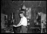 Man operating a film projector;