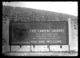 View of the Brigham City Free Camping Ground sign;