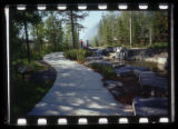 Walkway along a stream, Kananaskis Village, Alberta, Canada;