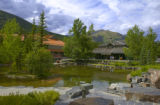 Resort hotel and pond at Kananaskis Village, Alberta, Canada;