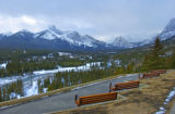 Walkways, trails, and benches with mountains and trees in the background at Kananaskis, Alberta;