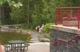 Patio and pond at resort hotel, Kananaskis, Village, Albert, Canada;