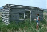 Debbie Randall evaluating log cabin at the Sam Kimball complex (GCCS_CDR021_11)