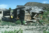 Deteriorated log cabin at the Lucas Ranch (GCCS_CDR024_16)