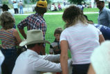 Rodeo participants signing up with Milt Oman for rodeo activities (GCCS_CDR027_5)