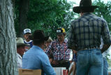 Rodeo participants signing up with Milt Oman for rodeo activities (GCCS_CDR027_6)