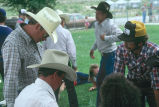 Rodeo participants signing up with Milt Oman for rodeo activities (GCCS_CDR027_7)
