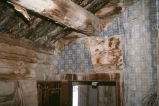 Interior view showing purlin and wallpaper, original log ranch house on the Warburton Ranch...