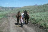 Doug Tanner and son, Tom, mounting horses for a cattle drive (GCCS_CTC021_17)
