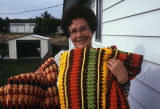Melissa Tanner with her crocheted afghans (GCCS_CCE011_1)