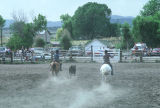 Unidentified riders team roping in the Fourth of July rodeo (GCCS_CTC027_8)