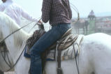 Close-up of unidentified rider on horseback at the Fourth of July rodeo (GCCS_CTC028_15)