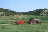 Oren Kimber driving tractor and baling hay on the Kimber Ranch meadow  (GCCS_CTC031_10)