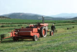 Oren Kimber driving tractor and baling hay on the Kimber Ranch meadow  (GCCS_CTC031_5)